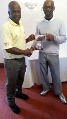 Ian Higgins Winner (left) receiving trophy from last years winner Rhucha Ford