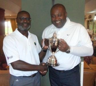 Winner - Emrys Karemo (left) receiving the TNCM trophy from Owen Mendez