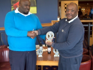 Winner Dean Leith (left) receiving his award from CGS vice-captain Lloyd Thomas
